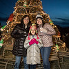 Teri Terrien with her daughters 4th grader Alexandra and 11th grader Sara in front of the Fox's Lobster House lobster trap Christmas Tree at the the annual lighting of the Nubble Lighthouse presented by the Town of York, Maine on Saturday 11-24-2018, Sohier Park, York Beach, ME.  [Matt Parker/Seacoastonline]Matt Parker Photos