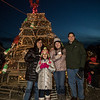 Scott Terrien with his family (L to R) Teri, 4th grader Alexandra and 11th grader Sara in front of the Fox's Lobster House lobster trap Christmas Tree at the the annual lighting of the Nubble Lighthouse presented by the Town of York, Maine on Saturday 11-24-2018, Sohier Park, York Beach, ME.  [Matt Parker/Seacoastonline]