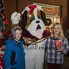 "Tyler Ebert (2nd grade) and sister Alexa (4th grade) of North Hampton enjoying popcorn pose for a photo with ""Maxine the Puppy"" of In-Dog-Neat-O at the 2018 Annual Christmas Tree Lighting at the Gazebo at Marelli Square sponsored by the Hampton Parks & Recreation Department on Friday Night, Hampton, NH, 11-30-2018.  Matt Parker Photos"