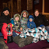 Tristan and Katie Nowak of Exter with their kids (L to R) Jude (1st grade), Halle (5th grade) and Rowan (preschool) found a front row curb seat at the 61st Annual Exeter Holiday Parade on Saturday 12-1-2018, Exeter NH.  [Matt Parker/Seacoastonline]
