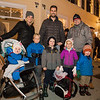 Erin and Ryan Nickerson with friend Jason Cohen (L) with their children (L to R) Vivian Nickerson (1 yr), Carter Nickerson (kg), Grady Cohen (kg), Zoey Nickerson (4yr) and Deacon Cohen (3yr) with a prime spot on the parade route at the 61st Annual Exeter Holiday Parade on Saturday 12-1-2018, Exeter NH.  [Matt Parker/Seacoastonline]