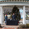 John Byra (Johnny B) of Party Time DJ's sets up his equipment while Mary looks on prior to the start of the 2018 Experience Hampton Christmas Parade on Saturday 12-1-2018, Rt. 1 Hampton, NH.  Matt Parker Photos