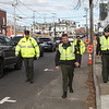 Officers of the  Hampton Police Department erect barriers in preparation for the 2018 Experience Hampton Christmas Parade on Saturday 12-1-2018, Rt. 1 Hampton, NH.  Matt Parker Photos