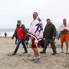 """18 year Penguin Plunge veteran Kevin Reusch is all smiles after exiting the water in the 1st wave at the 2018 Penguin Plunge to benefit the New Hampshire Special Olympics with the theme """"Glow Party"""" in the Atlantic Ocean on Sunday 2-4-2018 @ Hampton Beach, NH.  Matt Parker Photos"""