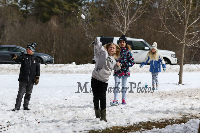 """Taking a break from maple syrup production with a friendly snowball fight at the Lincoln Akerman School 4th grade annual Sugaring Off Maple Syrup Party on Saturday 3-17-2018 @ the, """"LAS Sugar Shack"""", Hampton Falls, NH.  Matt Parker Phtotos"""
