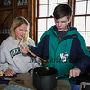 "6th grader Matthew Kriner stirs maple candy while 5th grader Elizabeth Medford looks on at the Lincoln Akerman School 4th grade annual Sugaring Off Maple Syrup Party on Saturday 3-17-2018 @ the, ""LAS Sugar Shack"", Hampton Falls, NH.  Matt Parker Phtotos"