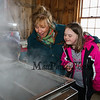 "Big Brother Big Sister volunteer Weezie Vance with Big Sister ""Alexa"" looking into the steaming evaporator at the Lincoln Akerman School 4th grade annual Sugaring Off Maple Syrup Party on Saturday 3-17-2018 @ the, ""LAS Sugar Shack"", Hampton Falls, NH.  Matt Parker Phtotos"