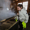 "4th grader Alivia Anastas looks into the evaporator at the boiling syrup at the Lincoln Akerman School 4th grade annual Sugaring Off Maple Syrup Party on Saturday 3-17-2018 @ the, ""LAS Sugar Shack"", Hampton Falls, NH.  Matt Parker Phtotos"