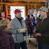 "LAS teacher and Sap Man Jim Cutting explains the maple syrup process to Matt and Molly Wynne at the Lincoln Akerman School 4th grade annual Sugaring Off Maple Syrup Party on Saturday 3-17-2018 @ the, ""LAS Sugar Shack"", Hampton Falls, NH.  Matt Parker Phtotos"