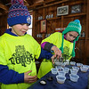 "4th graders Alec Mitchell and Ella Mitchell pour freshly made maple syrup into cups at the Lincoln Akerman School 4th grade annual Sugaring Off Maple Syrup Party on Saturday 3-17-2018 @ the, ""LAS Sugar Shack"", Hampton Falls, NH.  Matt Parker Phtotos"
