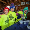 "4th graders Blake Cash, Alec Mitchell and Ella Mitchell pour freshly made maple syrup into cups at the Lincoln Akerman School 4th grade annual Sugaring Off Maple Syrup Party on Saturday 3-17-2018 @ the, ""LAS Sugar Shack"", Hampton Falls, NH.  Matt Parker Phtotos"
