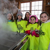 "4th graders (L to R) Ruby Stevens, Celina King, Reese Gandt, Madison Garrant and Alivia Anastas in front of the maple syrup evaporator at the Lincoln Akerman School 4th grade annual Sugaring Off Maple Syrup Party on Saturday 3-17-2018 @ the, ""LAS Sugar Shack"", Hampton Falls, NH.  Matt Parker Phtotos"