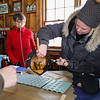 "Barb Cutting pours the maple candy into silicon molds at the Lincoln Akerman School 4th grade annual Sugaring Off Maple Syrup Party on Saturday 3-17-2018 @ the, ""LAS Sugar Shack"", Hampton Falls, NH.  Matt Parker Phtotos"