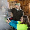 "LAS teacher and Sap Man Jim Cutting keeping the syrup process running with 4th grader Ruby Stevens feeling the steam come off the evaporator at the Lincoln Akerman School 4th grade annual Sugaring Off Maple Syrup Party on Saturday 3-17-2018 @ the, ""LAS Sugar Shack"", Hampton Falls, NH.  Matt Parker Phtotos"