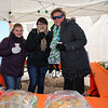 7th grader Caroline Bruno with Crystal Stevens and Brenda Braly at the snack table at the 2018 Salty's St. Paddy's Day Plunge to benefit the Chris Connors Fund at York Harbor Beach on Saturday March 17th, 2018.  Matt Parker Photos