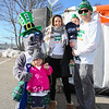 """Salty"" poses with Mark and Dani Nylen with daughter Emma (3-1/2) and son Jackson (1-1/2) at the 2018 Salty's St. Paddy's Day Plunge to benefit the Chris Connors Fund at York Harbor Beach on Saturday March 17th, 2018.  Matt Parker Photos"