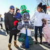 """Salty"" poses with (L) Kate Stone holding 2 year old River with Sheridan Ohlson and 4 year old daughter Shayla at the 2018 Salty's St. Paddy's Day Plunge to benefit the Chris Connors Fund at York Harbor Beach on Saturday March 17th, 2018.  Matt Parker Photos"