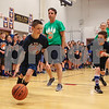 5th grader Nate McNeff comes up with ball after stealing it from Mr. Harrington with Andrew Haldpis (R) at the Stratham Memorial School annual 5th grade vs faculty and staff basketball game on Thursday 3-22-2018 @ SMS, Stratham, NH.  Matt Parker Photos