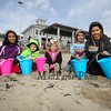 (L to R) Myrilla Chevalier (5th gr), with brother Nathaiel (5yr) and Ginny (3yr) with Gavin Follansbee (6yr) and Estevan Chevalier (4th gr) playing in the sand in anticipation of the start of the Easter Egg hunt at the 2018 Annual Hampton Beach Easter Egg Hunt by Hampton Recreation on Saturday at Hampton Beach, NH 3-24-2017.  Matt Parker Photos
