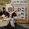 Anna Smith Strong AKA Elizabeth Carty stands in front of her work where she researched Anna Smith Strong of Setauket, New York an American Patriot, and she is thought to have been an important member of the Culper Spy Ring during the American Revolution at the Grade 4 Revolutionary War Wax Museum on Friday 5-11-2018 @ Seabrook Elementary School, Seabrook, NH.  Matt Parker Photos