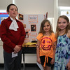 Abigail Box and Caydance Dow pose for a photo with John Hancock at the Grade 4 Revolutionary War Wax Museum on Friday 5-11-2018 @ Seabrook Elementary School, Seabrook, NH.  Matt Parker Photos