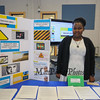 Student Aaliyah Kafanabo who prior to coming to Winnacunnet did not have access to a computer shows off her display which gives a summary of what she learned on her ELO in Digital Citizenship at the Winnacunnet High School ELO (Extended Learning Opportunities) Exhibition Night on Thursday 5-3-2018 @ WHS cafeteria, Hampton, NH.  Matt Parker Photos