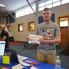 Student Jaden Lesperance shows off some of his graphic designs that he completed for his ELO in Business/Graphic Design at the Winnacunnet High School ELO (Extended Learning Opportunities) Exhibition Night on Thursday 5-3-2018 @ WHS cafeteria, Hampton, NH.  Matt Parker Photos