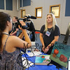 Student Nikki Tredwell getting filmed by a videographer at the Winnacunnet High School ELO (Extended Learning Opportunities) Exhibition Night on Thursday 5-3-2018 @ WHS cafeteria, Hampton, NH.  Matt Parker Photos