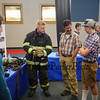 Student Daniel Melican Jr. talks with visitors to his booth where his fire fighting gear was on display where he studied his  ELO in Firefighting under-Hampton Fire/Rescue & Seabrook Fire Departments at the Winnacunnet High School ELO (Extended Learning Opportunities) Exhibition Night on Thursday 5-3-2018 @ WHS cafeteria, Hampton, NH.  Matt Parker Photos