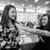 Student Michaela Maloney (R) poses for a photo with her sister Meredith showing some of the skills developed while studying her ELO in Self Defense and Life Skills at the Winnacunnet High School ELO (Extended Learning Opportunities) Exhibition Night on Thursday 5-3-2018 @ WHS cafeteria, Hampton, NH.  Matt Parker Photos