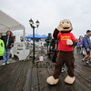 "Character ""Curious George"" and others wave as they disembark the M/V Thomas Laighton where they were picked up on ""Character Island"" at the start of Children's Day 2018 on Sunday 5-6-2018, Portsmouth, NH.  Matt Parker Photos."