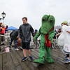 "Character ""Lyle the Crocodile"" and others wave as they disembark the M/V Thomas Laighton where they were picked up on ""Character Island"" at the start of Children's Day 2018 on Sunday 5-6-2018, Portsmouth, NH.  Matt Parker Photos."