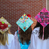 """Decorated caps with the graduates dreams (L to R) Kellie Haggerty """"Future Teacher"""", Madison Lavalle """"Adventure is Out There"""" and Sara Kondor-Ouellette """"Four Years Later"""" show off their caps prior to the march for the 115th, Wells High School Class of 2018 Graduation Ceremony on June 10, 2018, 1:00 PM, Wells, ME.  [Matt Parker/Seacoastonline]"""