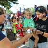 "Stephanie Westergren with her 2 year old son Tanner get ""sprinkles"" on their ice cream from Rosemary Hanley during the ice cream social at the Lane Library Summer Reading Finale celebration on Thursday 8-9-2018 @ Centre School, Hampton NH.  Matt Parker Photos"