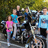 Officer Sonya Robicheau poses with a group of kids (L to R) Maddyson (7) and her brother Matthew Moro (4th grade), Officer Robicheau, Jake Conway (5th grade) and Teddy Bleicken (5th grade) on her motorcycle at the Exeter Police and Fire Departments Open House at the Exeter Safety Complex on Saturday 9-29-2017 @ Exeter, NH.  [Matt Parker/Seacoastonline]