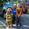 Lieutenant Mark Cook of the Exeter Fire Department poses with 3 year old Jill Johnson in her firefighters suit and her brother Drew (kindergarten) at the Exeter Police and Fire Departments Open House at the Exeter Safety Complex on Saturday 9-29-2017 @ Exeter, NH.  [Matt Parker/Seacoastonline]