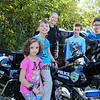 Officer Sonya Robicheau poses with a group of kids (L to R) Maddyson (7) and her brother Matthew Moro (4th grade), Officer Robicheau, Teddy Bleicken (5th grade) and Jake Conway (5th grade) on her motorcycle at the Exeter Police and Fire Departments Open House at the Exeter Safety Complex on Saturday 9-29-2017 @ Exeter, NH.  [Matt Parker/Seacoastonline]