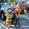 Lieutenant Mark Cook of the Exeter Fire Department poses with 3 year old Jill Johnson and her brother Drew (kindergarten) at the Exeter Police and Fire Departments Open House at the Exeter Safety Complex on Saturday 9-29-2017 @ Exeter, NH.  Matt Parker Photos