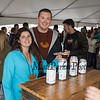 Katie Lessard and Trevor Ferguson try out the Woodstock Inn beers at the 11th Annual New Hampshire BrewFest on the grounds of Cisco Brewers, Pease Tradeport Portsmouth, NH on Saturday 10-12-2019.  [Matt Parker/Seacoastonline]