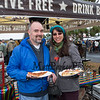 Brian and Andreea Dumez of Portsmouth enjoying beer and pizza at the 11th Annual New Hampshire BrewFest on the grounds of Cisco Brewers, Pease Tradeport Portsmouth, NH on Saturday 10-12-2019.  [Matt Parker/Seacoastonline]