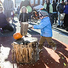 2 year old Henry Paulsen and his 4 year old sister Ella with their Dad all of Portsmouth  attack the pumpkin with the hammer at the Annual Pumpkin Smash held in conjunction with the Portsmouth Farmers' Market with all proceeds going to the Portsmouth Halloween Parade at Portsmouth City Hall on Saturday Oct. 2019.  Matt Parker Photos