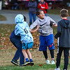 Stratham Memorial School 5th grader Jack Ferrelli gets stopped in a freindly football game at the Third Annual Family Fun Day community event at Stratham Hill Park on Saturday, October 19, 2018.  [Matt Parker/Seacoastonline]