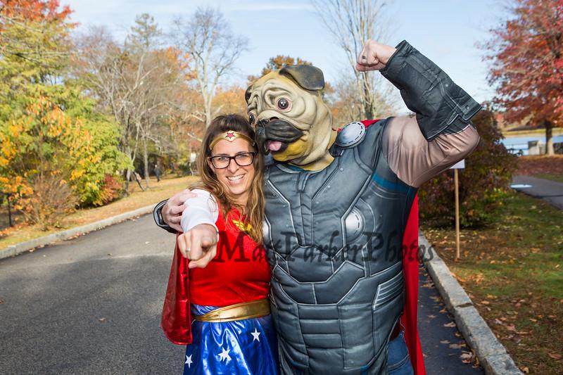 "Judges ""Thor-Pug"" AKA Dave Sullivan and his wife ""Wonder Woman"" AKA Brinn at Exeter's annual Halloween Parade on Saturday 10-26-2019 @ Swasey Parkway, Exeter NH.  Matt Parker Photos"