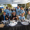 Volunteers and chili tasting judges (sitting L to R) Brian Comeau, Donna Buxton, 7th grader Troy Dean with his father Russ Dean pose for a photo at the 2019 Exeter Powder Keg Beer & Chili Festival on Swasey Parkway sponsored by the Exeter Area Chamber of Commerce and Exeter Parks and Recreation on Saturday 10-5-2018, Exeter NH.  [Matt Parker/Seacoastonline]