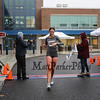 """19:44 Kylie McCoy            27 F  3058 Boston MA breaks the tape taking first place in the womens division, Fill The Pantry 5k, """"Tis The Season To Run for A Reason"""", benefit road race organized by the Seacoast Education Association, PTA and area schools on Saturday 12-14-2019 @ Hampton Academy, Hampton NH.  Matt Parker Photos"""