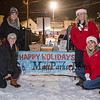(L to R) Molly Drescher (kneeling) and Emma Smith of Aroma Joes with Emma Ratigan (kneeling) and Tiana Williams of Service Credit Union serving up hot chocolate and cookies at the 2019 Annual Christmas Tree Lighting at the Gazebo at Marelli Square sponsored by the Hampton Parks & Recreation Department on Friday Night 12-6-2019, Hampton, NH.  Matt Parker Photos