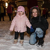 New Hampton residents 1-1/2 year old Violet Agri and 3rd grader Lily Bowes pose for a photo in the newly fallen snow at the 2019 Annual Christmas Tree Lighting at the Gazebo at Marelli Square sponsored by the Hampton Parks & Recreation Department on Friday Night 12-6-2019, Hampton, NH.  Matt Parker Photos