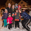 Friends, (L to R) front, pre-schooler Brynn Russ, Eleonore Dodge, 1st grader Jameson Alcombright with mom Heather, back row, Natalie Russ, Bree Dodge, Melanie and Melanie Alcombright posing for a photo with light snow falling at the 2019 Annual Christmas Tree Lighting at the Gazebo at Marelli Square sponsored by the Hampton Parks & Recreation Department on Friday Night 12-6-2019, Hampton, NH.  Matt Parker Photos