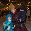 Hampton residents Fawn Whitney with 3rd grader Harper and 1 year old Lincoln enjoying the tree lighting while light snow falls at the 2019 Annual Christmas Tree Lighting at the Gazebo at Marelli Square sponsored by the Hampton Parks & Recreation Department on Friday Night 12-6-2019, Hampton, NH.  [Matt Parker/Seacoastonline]
