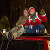 Becka Cail and Rick Evans of Exeter making themselves comfortable with seating on top of their 4Runner at the 62nd Annual Exeter Holiday Parade on Saturday Night 12-7-2019, Exeter NH.  [Matt Parker/Seacoastonline]